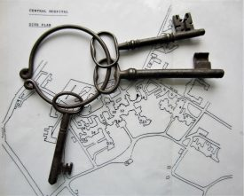 3 large keys on a metal ring lying on a site plan of Central Hospital | Image courtesy of Anne Langley
