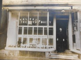 My parental grandmother Elsie Agnes Mary Jakeman on the steps of the royal dairy around 1910. Jars such as the green jar in the other picture can be seen in the window. | Image courtesy of Richard Neale