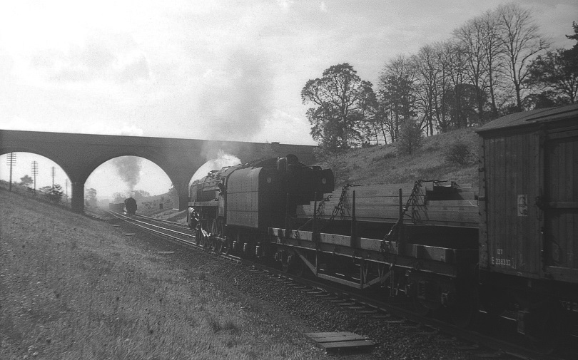 North and southbound freights converging at the Ashlawn Road bridge south of Rugby Central.   Image courtesy of the Tony Newman collection