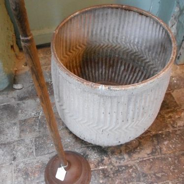 Dolly tub and posh, part of the Scullery at Chilvers Coton Heritage Centre | Image courtesy of Chilvers Coton Heritage Centre