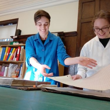 Dis-binding and cleaning the volumes | Image courtesy of Warwickshire County Record Office
