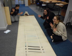 Obligatory team jazz-hands photo. Excitement as we unroll the section plan | Image courtesy of Warwickshire County Record Office
