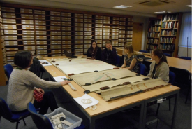 The team assemble in the searchroom at the record office to consider some of the collection's older and more fragile maps. | Image courtesy of Warwickshire County Record Office