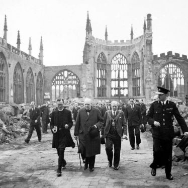 Winston Churchillwalking through the ruined nave ofCoventry Cathedral, after it was severely damaged in theCoventry Blitzof 14–15th November 1940 | Image taken by Capt Horton, War Office official photographer, Courtesy of Imperial War Museum. H_14250 Imperial War Museum Archives