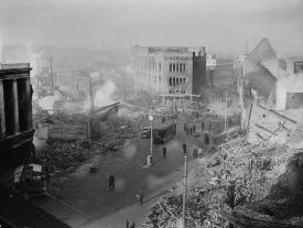 Broadgate inCoventrycity centre following theCoventry Blitzof 14/15 November1940. The burnt out shell of theOwen Owendepartment store (which had only opened in 1937) overlooks a scene of devastation.   Image taken by Taylor (Lt) - War Office official photographer, courtesy of Imperial War Museum. H5600 Imperial War Museum Archives