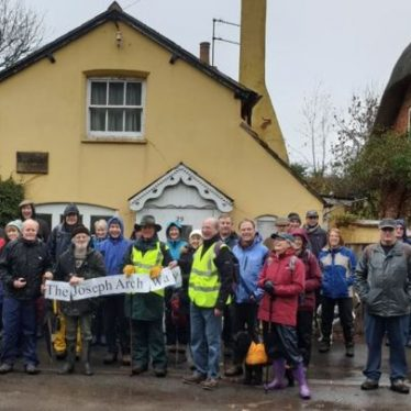 A gathering of people in front of Joseph Arch's former home in Barford, commemorating the 100th anniversary of his death. | Image courtesy of Gary Stocker.