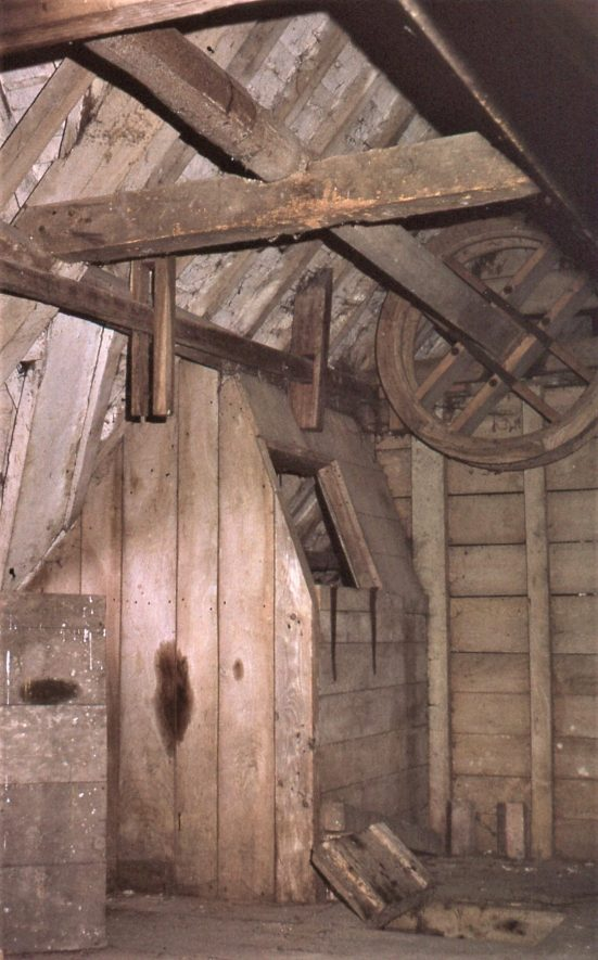 Weston Mill, Cherington, May 1973. A garner (grain bin) and the sack hoist on the top floor | Image courtesy of Tim Booth