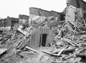Black and white photo of an Anderson shelter surviving after a raid in London during World War Two | Image courtesy of Imperial War Museum, Ref: D5949