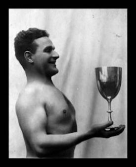 Photo of August Louis Schneider with the Ernest Hadow Challenge Swimming Cup | Photo courtesy of the Schneider family