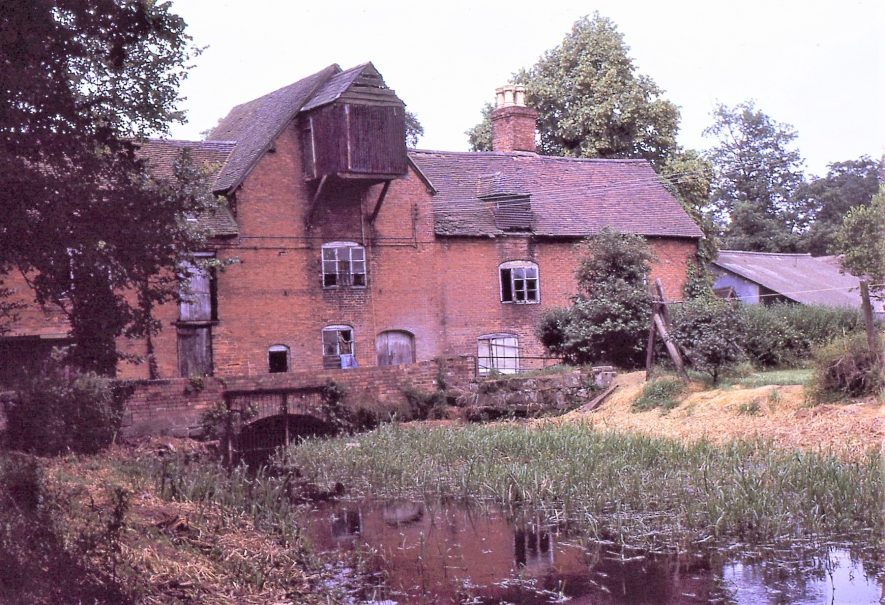 Maxstoke Mill, July 1971, the mill and mill house. Maxstoke Mill has been demolished but the waterwheel and pit wheel were left in position. | Image courtesy of Tim Booth