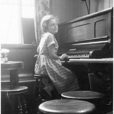 Photo of Margaret Eastham on the piano in the Dugdale Arms | Photo courtesy of Margaret Eastham