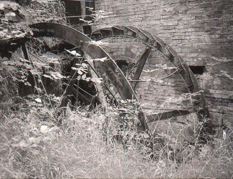 Packington Mill, Great Packington, July 1971. The remains of the iron overshot waterwheel, 14ft x 6ft 3in, in the northern wheel pit. | Image courtesy of June Booth