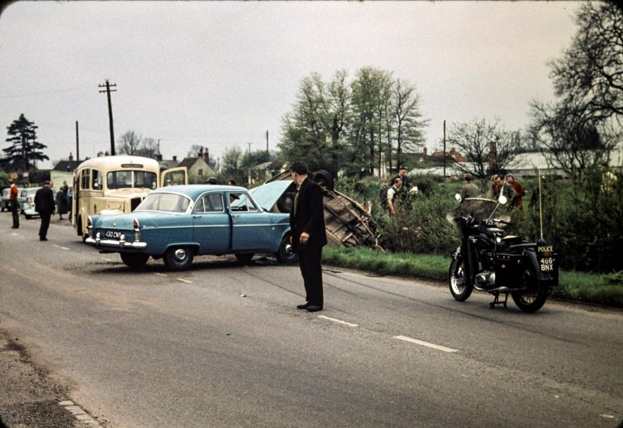 Car accident early 1960s, including ambulance and police motorbike. Likely to be near Alcester | Slide photo taken by my uncle Neil Campbell, who lived in King's Coughton. Bernard Campbell digitised the photo.