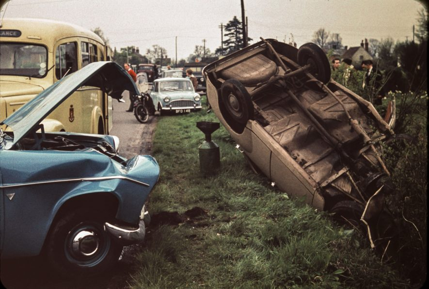 Car accident early 1960s, including ambulance. Likely to be near Alcester | Slide photo taken by Neil Campbell who lived in King's Coughton. Bernard Campbell digitised the photo.